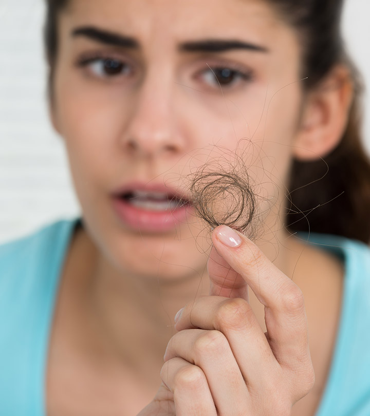 Image of a girl holding her hairs