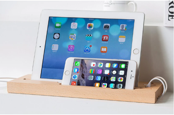 A wooden Tray to Place all their Tech Gadgets